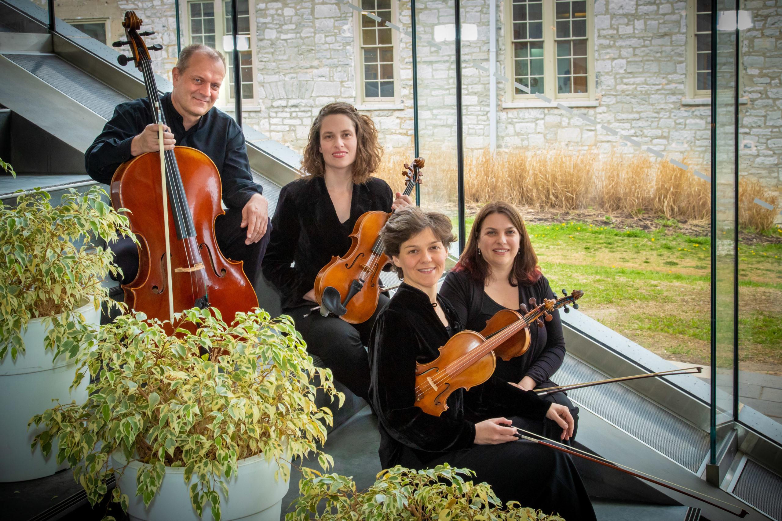 Quartet sitting with Tett Centre behind